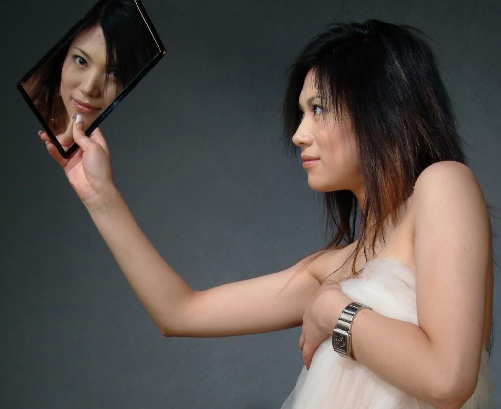 female looking at herself in a mirror